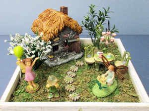 A fairy garden 'dollhouse'.