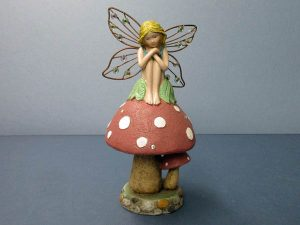 Fairy on a mushroom.